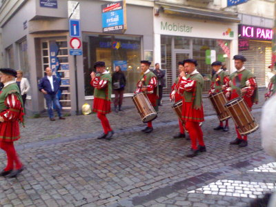 The parade on Rue du Marche aux Herbes