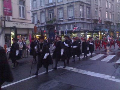 The parade continues on Rue du Lombard…
