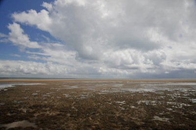 Rain showers arriving over the rocks at low tide (Corumbau, Bahia, Brazil)